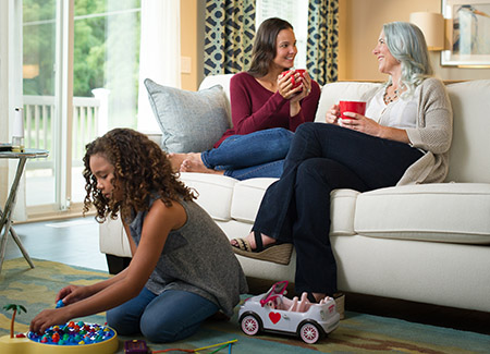 lifestyle image of family in living room